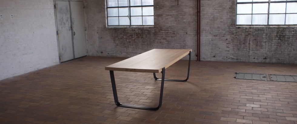 Solid ash tabletop with our Black smith's frame