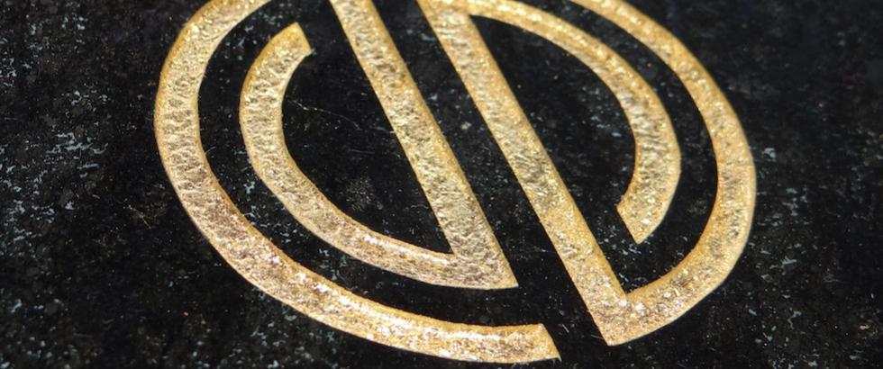 VanDen furniture gold logo